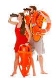 Lifeguards with rescue ring buoy and life vest. Stock Images