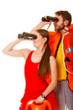 Lifeguards with rescue ring buoy and life vest. Lifeguards with rescue tube ring buoy lifebuoy and life vest jacket looking through binoculars. Man and women stock images