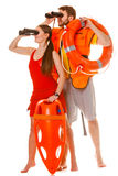 Lifeguards with rescue ring buoy and life vest. Lifeguards rescue tube ring buoy lifebuoy and life vest jacket looking through binoculars. Man and women royalty free stock photos
