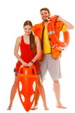 Lifeguards with rescue ring buoy and life vest. Lifeguards with rescue tube ring buoy lifebuoy and life vest jacket. Man and women supervising swimming pool royalty free stock photo