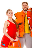 Lifeguards with rescue ring buoy and life vest. Lifeguards with rescue tube ring buoy lifebuoy and life vest jacket. Man and women supervising swimming pool stock photo