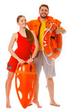 Lifeguards with rescue ring buoy and life vest. Lifeguards with rescue tube ring buoy lifebuoy and life vest jacket. Man and women supervising swimming pool stock photography