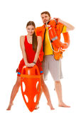 Lifeguards with rescue ring buoy and life vest. Stock Image