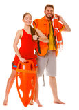 Lifeguards with rescue ring buoy and life vest. Lifeguards with rescue tube ring buoy lifebuoy and life vest jacket showing thumb up gesture. Man and women stock images