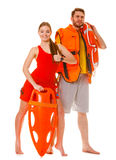 Lifeguards with rescue ring buoy and life vest. Lifeguards with rescue tube ring buoy lifebuoy and life vest jacket showing thumb up gesture. Man and women stock photos
