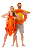 Lifeguards with rescue and ring buoy lifebuoy. Royalty Free Stock Images