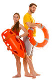 Lifeguards with rescue and ring buoy lifebuoy. Royalty Free Stock Photo