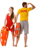 Lifeguards with rescue and ring buoy lifebuoy. Stock Image