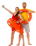 Lifeguards with rescue and ring buoy lifebuoy. Royalty Free Stock Image