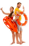 Lifeguards with rescue and ring buoy lifebuoy. Stock Images