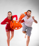 Lifeguards running with equipment Royalty Free Stock Images