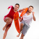 Lifeguards running with equipment Stock Photography