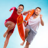 Lifeguards running with equipment Royalty Free Stock Photos