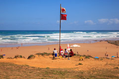 Lifeguards sitting on surveillance post Royalty Free Stock Photo