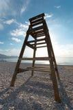 Lifeguart seat. Wooden life guard high seat on a pebble beach Stock Photo