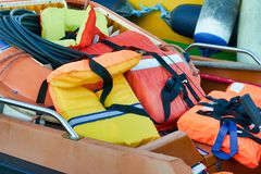 Lifejacket in a red boat. Ready for maintenance stock photography