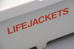 Lifejackets box. The word LIFEJACKETS written in orange capital letters in front on a white box stock photo