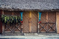Lifejackets hang at the entrance to the store. The facade of the wooden structure.  stock images