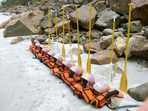 Lifejackets and oars lined up. For rafting, rishikesh, india royalty free stock image