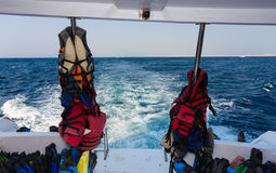 Lifejackets and other equipment for diving on back teak deck. Of a motor yacht stock photos