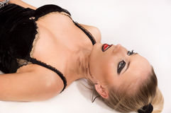 Lifeless blonde lying on the floor Royalty Free Stock Images