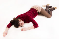 Lifeless brunette lying on the floor Royalty Free Stock Photography