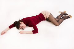 Lifeless brunette lying on the floor Stock Photo