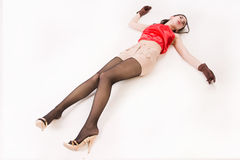 Lifeless brunette lying on the floor Stock Images