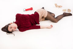 Lifeless brunette lying on the floor Royalty Free Stock Photo