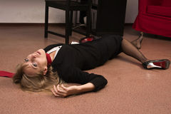 Lifeless business woman lying on the floor Royalty Free Stock Images