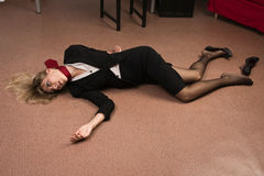 Lifeless business woman lying on the floor Stock Images