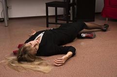 Lifeless business woman lying on the floor Royalty Free Stock Photos