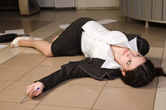 Lifeless businesswoman in a office Stock Images