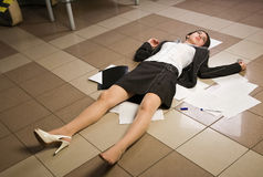 Lifeless businesswoman in a office Stock Photo