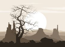 Lifeless landscape with old tree and mountains Stock Photo