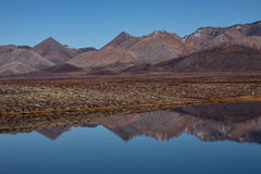 Lifeless mountains with a reflection in the lake. Royalty Free Stock Photography