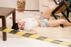 Lifeless woman lying on the floor (imitation) Royalty Free Stock Image