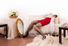Lifeless woman lying on the sofa Royalty Free Stock Photography