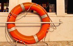 The lifeline equipment in Sea. Life buoy tied to a sail boat to carry out rescue operations for throwing them to the ones in need in oceans Royalty Free Stock Image