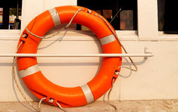 The lifeline equipment in Sea. Life buoy tied to a sail boat to carry out rescue operations for throwing them to the ones in need in oceans Stock Photos