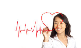 Lifeline with heart love concept. Beauty Asian woman Drawing lifeline with heart concept graph on the whiteboard Stock Photos