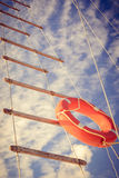 Lifeline ladder. Lifebuoy and a ladder on the boat Stock Photos