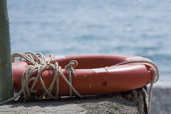 Lifeline. Lifebuoy with rope on the background of the sea Royalty Free Stock Photo
