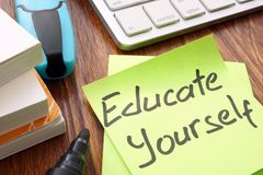 Lifelong learning. Sign educate yourself on a memo. Lifelong learning concept. Sign educate yourself on a memo stock photo