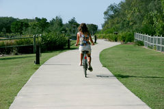 Lifes good. Riding bicycle along pathway Royalty Free Stock Photo
