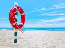 Lifesaver on beach Royalty Free Stock Photos