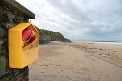 Lifesaver buoy on empty beach Stock Photos