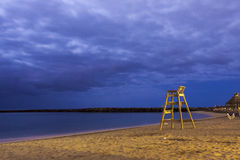 Lifesaver chair. On beach night shoot Stock Image