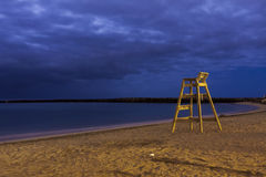 Lifesaver chair. On beach night shoot Stock Images