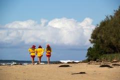 Lifesaver girls. Three lifesaver girls on Mollymook beach, NSW, Australia stock images